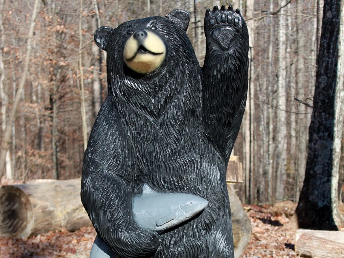 Waving black bear with a catfish